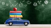 kırtasiye : Back to school looped 4k animation. Car delivering books and apple against green colored school blackboard with education symbols.