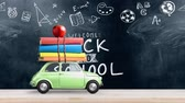 kırtasiye : Back to school looped 4k animation. Car delivering books and apple against school blackboard with education symbols. Car is moving from left to right.