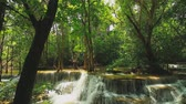 bystřina : Huay Mae Khamin Waterfall flows from the natural green forest in the rainy season,Kanchanaburi Province, Thailand Dostupné videozáznamy