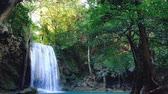 칸차나 부리 : Jungle landscape with flowing blue water of Erawan waterfall with beautiful  in the  Kanchanaburi Province, Thailand.