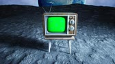sintonizador : old wooden vintage TV on the moon. Earth background. Space concept. Broadcast. Green screen tracking footage. Stock Footage