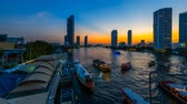 chao phraya : Time lapse 4k Day to night. Bussy traffic at Saphan Taksin pier Bangkok Thailand