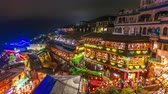 Time lapse of Jiufen in the evening with many tourists. Wideo