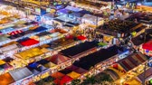 Time lapse of Bangkok city business downtown and train night market Ratchada,Thailand Wideo
