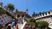 modernism : Unidentified people in Parc Guell - famous park designed by Antoni Gaudi in Barcelona, Catalonia, Spain Stock Footage