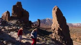 roques : Unidentified people walking in front of the Roques del Garcia in Parque Nacional del Teide - Teide National Park, Canary Islands, Spain