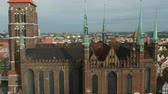 bem aventurado : Poland, Pomeranian Voivodeship, Gdansk, Elevated view of the Old Town, St. Marys Basilica Stock Footage