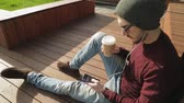 sloppy : Handsome hipster using app and listening to music in smartphone headphones Stock Footage