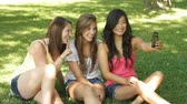 fashion : Young beautiful women talking and hanging out in park