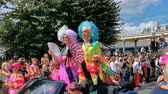 funny and beautiful drag queens with fans waving and driving by in a car, LGBT pride parade antwerp, 10 August, 2019, Antwerp, Belgium Стоковые видеозаписи