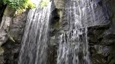 libra : Beautiful waterfalls streaming or big rock cliffs, Nature background Vídeos