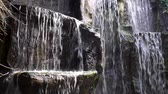 libra : Waterfalls streaming or rocks in closeup, beautiful nature background Vídeos