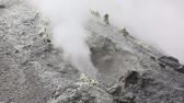 stink : Volcanic activity on Kamchatka Peninsula: thermal, fumarole field in crater of active Mutnovsky Volcano - view of the eruption of steam and gas from fumaroles. Eurasia, Russia, Far East, Kamchatka Region.
