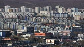 multistory : Architecture of the Petropavlovsk-Kamchatsky City - view of an array of new modern multistorey buildings and old houses (evening soft lighting). Kamchatka Peninsula, Russian Far East, Eurasia.