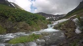 cone : Kamchatka Peninsula summer mountain landscape - view of picturesque rough mountain river in sunny weather. Mountain Range Vachkazhets, Kamchatka Region, Russian Far East, Eurasia. Stock Footage
