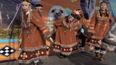 абориген : KAMCHATKA PENINSULA, RUSSIA - NOV 4, 2018: Women and men in national clothing indigenous inhabitants Kamchatka dancing. Public concert, celebration of Koryak national holiday Hololo (Day of Seal).