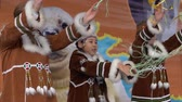 абориген : KAMCHATKA PENINSULA, RUSSIA - NOV 4, 2018: Group of Girls dancing in national clothing indigenous inhabitants Kamchatka. Celebration of Koryak national holiday Hololo (Day of Seal). Slow motion