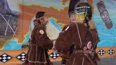 абориген : KAMCHATKA PENINSULA, RUSSIA - NOV 4, 2018: Women in national clothing indigenous inhabitants Kamchatka dancing. Public concert, celebration of Koryak national ritual holiday Hololo (Day of Seal).