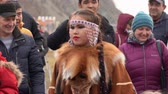 абориген : KAMCHATKA PENINSULA, RUSSIA - NOV 4, 2018: Young woman dancing in national clothing indigenous Kamchatka decorated with red fox. Celebration of Koryak national holiday Day of Seal (Hololo).