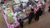vitrin : PETROPAVLOVSK KAMCHATSKY CITY, KAMCHATKA PENINSULA, RUSSIAN FAR EAST - 30 NOV, 2018: Top view of fish shop trading department, people buying fish and seafood at popular central city fish market.