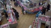 clams : PETROPAVLOVSK KAMCHATSKY CITY, KAMCHATKA PENINSULA, RUSSIAN FAR EAST - 30 NOV, 2018: Top view of fish shop trading department, people buying seafood and fish at popular central town fish market.
