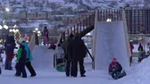 kamchatka peninsula : PETROPAVLOVSK KAMCHATSKY CITY, KAMCHATKA PENINSULA, RUSSIAN FAR EAST - DEC 31, 2018: Children ride from winter ice slide located in snowy town Happy New Year in center of capital Kamchatka Territory. Stock Footage
