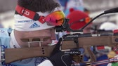 ассортимент : Sportsman biathlete aiming, rifle shooting and reloading rifle in prone position. Biathlete Zlobin Vladislav in shooting range. Youth biathlon competitions East Cup. Kamchatka, Russia - April 12, 2019 Стоковые видеозаписи