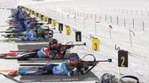 Group of sportswoman biathlete aiming, rifle shooting in prone position on shooting range biathlon arena. Junior biathlon competitions East Cup. Petropavlovsk City Kamchatka, Russia - April 13, 2019. Stok Video
