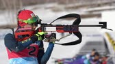 cazaquistão : Sportswoman biathlete aiming, rifle shooting, reloads standing position. Biathlete Polina Yegorova Kazakhstan in shooting range. Junior biathlon competitions East Cup. Kamchatka, Russia - Apr 14, 2019 Vídeos