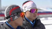 Two biathletes of South Korea biathlon team during at shooting range stadium during Junior biathlon competitions East of Cup. Petropavlovsk City, Kamchatka Peninsula, Russian Far East - April 14, 2019