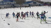 Group of sportswoman biathlete skiing on snow ski track biathlon stadium - mass start Junior biathlon competitions East of Cup. Petropavlovsk City, Kamchatka Peninsula, Russian Far East - Apr 13, 2019