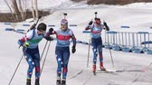 Saint Petersburg team sportsman biathletes Roduner Dionis and Starovoitova Anna skiing snow ski track relay race Junior biathlon competitions East of Cup. Kamchatka Peninsula, Russia - April 14, 2019.