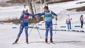 Kamchatka team sportsman biathletes Smolyakov Danila and Miroshnichenko Maria skiing snow ski track relay race Junior biathlon competitions East of Cup. Kamchatka Peninsula, Russia - April 14, 2019.