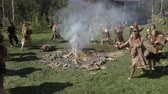 Group Itelmens people dancing ritual dance near fire and scream in traditional clothing aboriginal. Itelmens national ritual festival thanksgiving nature Alhalalalay. Kamchatka, Russia - Sep 14, 2019 Filmati Stock
