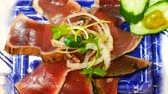 rúcula : Raw Tuna-fish, Tuna sushi was sliced with salad on traditional Japanese dish. Traditional Japanese food.