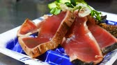 szezámmag : Raw Tuna-fish, Tuna sushi was sliced with salad on traditional Japanese dish. Traditional Japanese food.