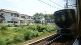 Footage of High Speed electric train are running on the railroad tracks in Japan.