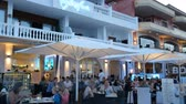 upscale : Cala Ratjada Mallorca Spain: Tourists dining in upscale white restaurant in the evening