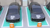 Metallic gray electric car in car sharing only parking lot. 3D rendering animation.