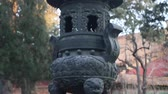 wazon : closeup of a vase in the forbidden city with group of people wearing surgical masks