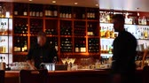 baton : VANCOUVER,CANADA - CIRCA July 2012 :bar tender with martinis at chic sushi bar Wideo