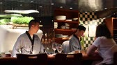 baton : VANCOUVER,CANADA - CIRCA July 2012 :chefs at chc sushi bar