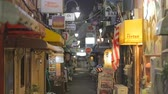 TOKYO,JAPAN - CIRCA March 2015 :many bars in the alley - night Shinjuku Golden Gai Stock Footage