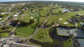 court de tennis : Terrain de golf à un country club en Floride