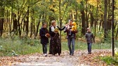 parent : Big Family Walking Along Autumn Path father mother and children
