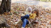 parent : Mother and child walking in autumn park Stock Footage