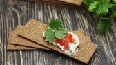 cracker : Crispbread with soft cottage cheese and red pepper