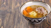 coentro : uzbek soup on wooden table Stock Footage