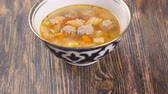 mutton : uzbek soup on wooden table Stock Footage