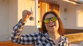 real estate sign : Happy young woman with New House Keys